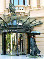 Private VIP entrance to the Casino of Monte Carlo, Monaco, with life-size sculpted people in 19th century dress.