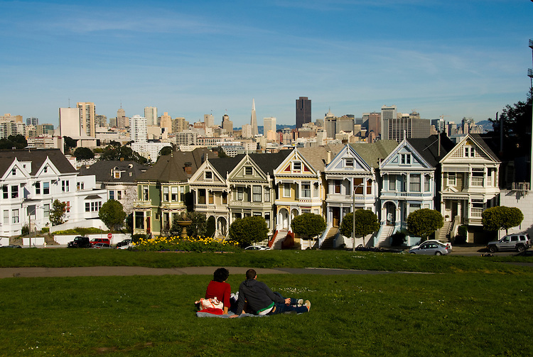 California: San Francisco. People relaxing in Alamo Square with view of Victorians and modern downtown. Photo copyright Lee Foster. Photo #: san-francisco-alamo-square-20-casanf77508