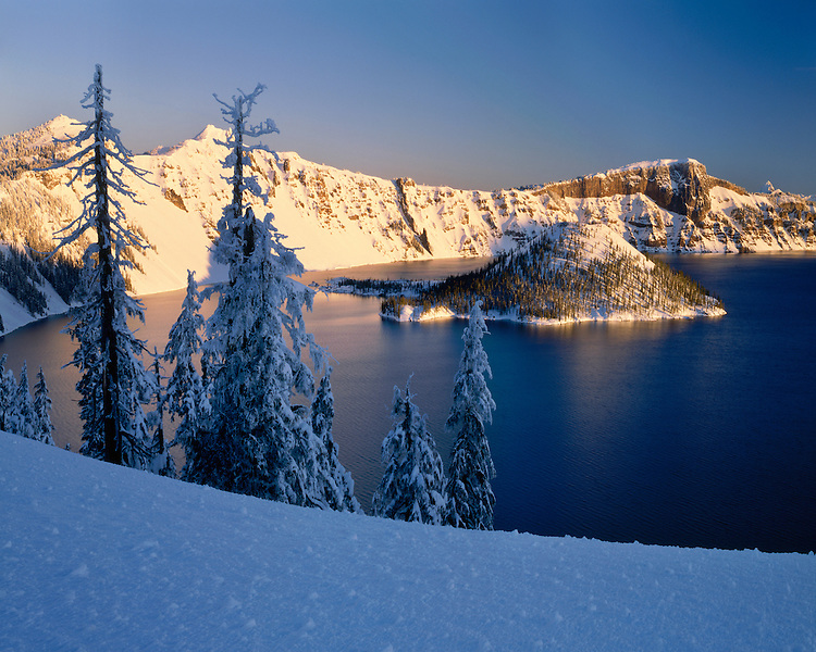 Winter sunrise light on Wizard Island; Crater Lake National Park, OR