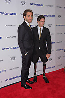 www.acepixs.com<br /> <br /> September 14 2017, New York City<br /> <br /> Jeff Bauman (R) and actor Jake Gyllenhaal arriving at the premiere of 'Stronger'  at the Walter Reade Theater on September 14, 2017 in New York City.<br /> <br /> By Line: Curtis Means/ACE Pictures<br /> <br /> <br /> ACE Pictures Inc<br /> Tel: 6467670430<br /> Email: info@acepixs.com<br /> www.acepixs.com