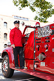 USA, California, San Francisco, a man prepares to take tourists across the Golden Gate Bridge on an old restored firetruck, located at the end of Columbus Avenue