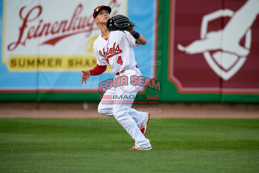 Peoria Chiefs left fielder Matt Davis (4) tracks a fly ball during a game against the West Michigan Whitecaps on May 8, 2017 at Dozer Park in Peoria, Illinois.  West Michigan defeated Peoria 7-2.  (Mike Janes/Four Seam Images)