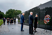 Family members of Sen. John McCain, R-Ariz., watch as his wife, Cindy McCain, right, accompanied by President Donald Trump's Chief of Staff John Kelly, third from right, and Defense Secretary Jim Mattis, second from right, lays a wreath at the Vietnam Veterans Memorial in Washington, Saturday, Sept. 1, 2018, during a funeral procession to carry the casket of her husband from the U.S. Capitol to National Cathedral for a Memorial Service. McCain served as a Navy pilot during the Vietnam War and was a prisoner of war for more than five years. <br /> Credit: Andrew Harnik / Pool via CNP
