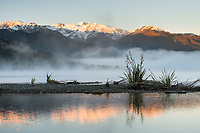 Sunrise on Southern Alps with mist on Lake Mapourika, Westland Tai Poutini National Park, UNESCO World Heritage Area, South Westland, New Zealand, NZ
