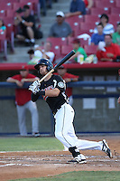 Tyler Smith #12 of the Visalia Rawhide bats against the High Desert Mavericks at Heritage Field on July 19, 2014 in Adelanto, California. Visalia defeated High Desert, 10-9. (Larry Goren/Four Seam Images)