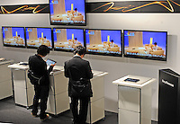 Customers look at the new Sony Tablets for sale in Ginza, Tpkyo..............