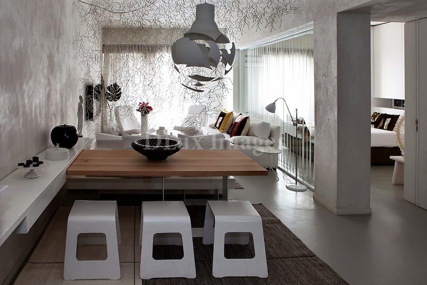 modern contemporary dining room...Katia Margaritoglou, her husband Sotiris Tsergas and their baby son live in Athens, Greece in a minimal white house, where most of the furniture is custom made.