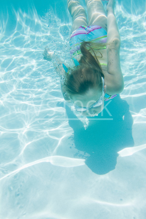 USA Florida, St. Pete Beach, Underwater shot of girl (8-9) diving