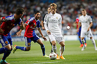 Luka Modric of Real Madrid and Samuel and Mohamed Elneny of FC Basel 1893 during the Champions League group B soccer match between Real Madrid and FC Basel 1893 at Santiago Bernabeu Stadium in Madrid, Spain. September 16, 2014. (ALTERPHOTOS/Caro Marin) /NortePhoto.com