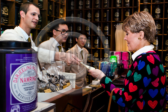"PARIS - FRANCE - 08 MAY 2011 -- Paris travel city photos. -- Tea house ""Mariage Freres"" Rue des Grands Augustins 13. Helena PETAISTO (Petäistö) correspondent of the Finnish TV MTV3 purchasing some tea. -- PHOTO: Juha ROININEN / EUP-IMAGES"