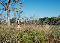 Bret Bergmeier, age 16, shoots a dove during opening day of dove hunting season near Wamego, Kansas, Sunday, September 1, 2013. Opening day is known for being a festive day of hunting with family and friends. <br /> <br /> Photo by Matt Nager