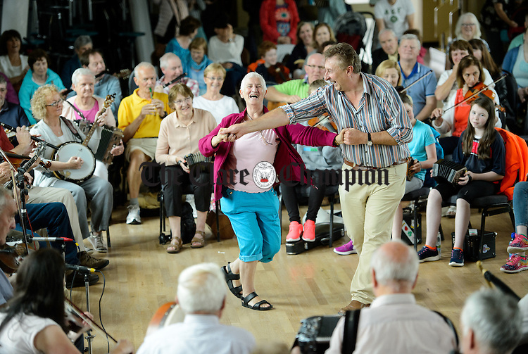 Dancers take to the floor at the Frank Custy session at the Holy Family National School during Fleadh Cheoil na hEireann in Ennis. Photograph by John Kelly.