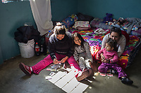 MEXICALI, MEXICO - February 20. A group of migrants play cards in the Alfa y Omega Shelter on February 20, 2019 in Mexicali, Mexico.<br />  A new group of Central American migrants arrived to the city, mostly young men. Some manifest their desire to remain on Mexican soil but for others the idea of crossing the border fence is still attractive.<br /> US President Donald Trump uses emergency powers to secure funding for his proposed US-Mexico border wall. In this case, Trump has claimed there is a migration crisis on the US-Mexico border.<br /> (Photo by Luis Boza/VIEWpress)