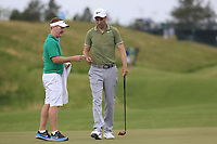 Ross Fisher (ENG) and caddy Mark Sherwood on the 17th green during Wednesday's Practice Day of the 117th U.S. Open Championship 2017 held at Erin Hills, Erin, Wisconsin, USA. 14th June 2017.<br /> Picture: Eoin Clarke | Golffile<br /> <br /> <br /> All photos usage must carry mandatory copyright credit (&copy; Golffile | Eoin Clarke)