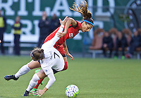 Portland, Oregon - Saturday May 21, 2016: The Portland Thorns Nadia Nadim (9) and Washington Spirits Christine Nairn (7) during a regular season NWSL match at Providence Park. The Thorns won 4-1.