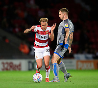 Lincoln City's Michael O'Connor vies for possession with Doncaster Rovers' James Coppinger<br /> <br /> Photographer Chris Vaughan/CameraSport<br /> <br /> EFL Leasing.com Trophy - Northern Section - Group H - Doncaster Rovers v Lincoln City - Tuesday 3rd September 2019 - Keepmoat Stadium - Doncaster<br />  <br /> World Copyright © 2018 CameraSport. All rights reserved. 43 Linden Ave. Countesthorpe. Leicester. England. LE8 5PG - Tel: +44 (0) 116 277 4147 - admin@camerasport.com - www.camerasport.com