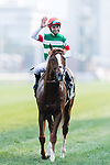 Brazilian jockey Joao Moreira riding Neorealism celebrates after winning the Audemars Piguet QEII Cup horse race at Sha Tin race course in Hong Kong, China. (Photo by Marcio Rodrigo Machado / Power Sport Images)