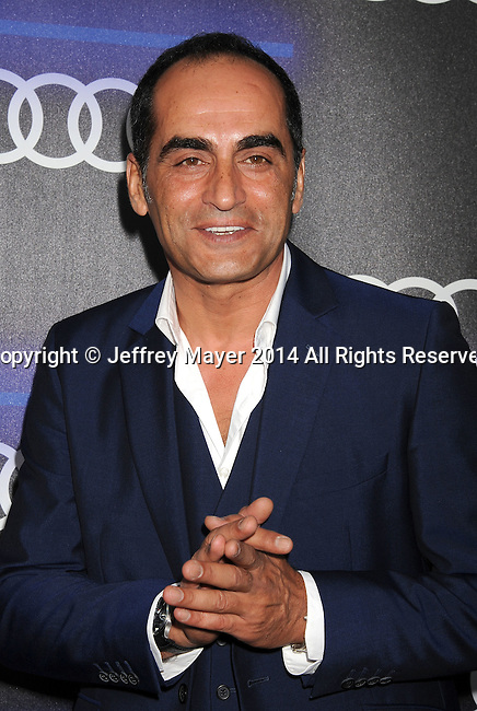 LOS ANGELES, CA- AUGUST 21: Actor Navid Negahban arrives at the Audi Emmy Week Celebration at Cecconi's Restaurant on August 21, 2014 in Los Angeles, California.