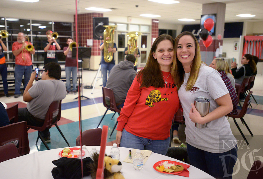 NWA Democrat-Gazette/BEN GOFF @NWABENGOFF<br /> Beth Chessher (left) and Sarah Kuhnert, both members of the first class of 6th graders to attend Greer Lingle Middle School, chat on Monday Jan. 16, 2017 during a 20th anniversary celebration at the school in Rogers. The school opened with just 6th grade in the fall of 1996, with 7th graders arriving in Jan. of 1997. Since Aug. 2008 the school has also had 8th grade.