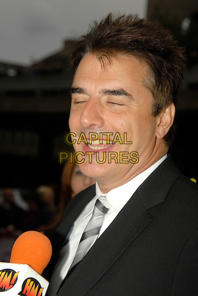 CHRIS NOTH .Attending the National Movie Awards 2008 held at The Royal Festival Hall, London, England, 8th September 2008. .portrait headshot   tie microphone  being interviewed funny eyes shut .CAP/IA.©Ian Allis/Capital Pictures