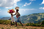 A woman and her daughter walk home from the market in Les Palmes, a rural village in southern Haiti where the Lutheran World Federation has been working with survivors of the 2010 earthquake, along with other residents, to experience more abundant life.