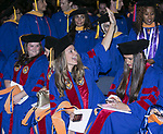 Graduates search for their friends and family members in the stands Sunday, June 11, 2017, during the DePaul University College of Science and Health and College of Liberal Arts and Social Sciences commencement ceremony at the Allstate Arena in Rosemont, IL. (DePaul University/Jamie Moncrief)