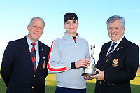 John White (Chairman GUI Ulster) presents the Trophy to Thomas Higgins (Roscommon) winner of the Ulster Boys Championship at Portrush Golf Club, Valley Links, Portrush, Co. Antrim on Thursday 1st Nov 2018.<br /> L-R: Dr. Robert Brady (Captain Royal Portrush, Thomas Higgins (Roscommon) and John White (Chairman GUI Ulster)<br /> Picture:  Thos Caffrey / www.golffile.ie<br /> <br /> All photo usage must carry mandatory copyright credit (&copy; Golffile | Thos Caffrey)