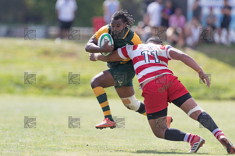 Rupeni Vosayaco tries to get past Walter Fifita. Counties Manukau Premier Counties Power Club Rugby game between Karaka and Pukekohe, played at the Karaka Sports Park on Saturday March 10th 2018. Pukekohe won the game 31 - 27 after trailing 5 - 20 at halftime.<br /> Photo by Richard Spranger.
