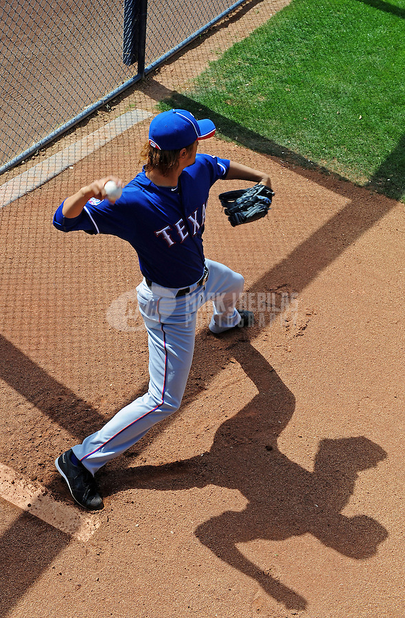 Mar. 7, 2012; Peoria, AZ, USA; Texas Rangers pitcher Yu Darvish warms up in the bullpen prior to the game against the San Diego Padres at Peoria Stadium.  Mandatory Credit: Mark J. Rebilas-.