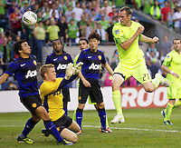 Seattle Sounders FC forward Nate Jaqua, right, takes a shot on on Manchester United goalkeeper Ben Amos during play at CenturyLink Field in Seattle Wednesday July 20, 2011. Manchester United won the match 7-0.