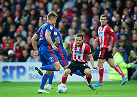 Lincoln City's Jack Payne battles with Sunderland's Max Power<br /> <br /> Photographer Andrew Vaughan/CameraSport<br /> <br /> The EFL Sky Bet League One - Lincoln City v Sunderland - Saturday 5th October 2019 - Sincil Bank - Lincoln<br /> <br /> World Copyright © 2019 CameraSport. All rights reserved. 43 Linden Ave. Countesthorpe. Leicester. England. LE8 5PG - Tel: +44 (0) 116 277 4147 - admin@camerasport.com - www.camerasport.com