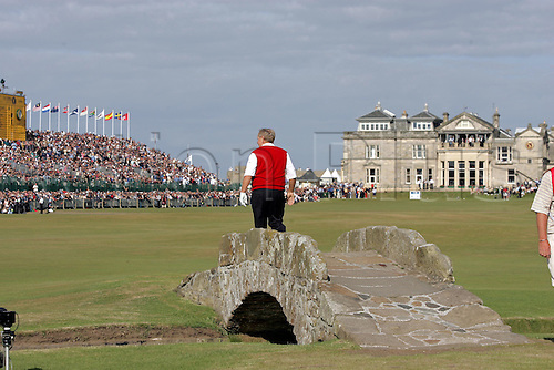 15 July 2005: Veteran golfer Jack Nicklaus (USA) turns his back on photographers walking across the Swilcan Bridge in front of the Clubhouse after his second round, his final round in a competitive tournament . Nicklaus missed the cut, shooting a 2nd round  72 to be 3 over par after 2 rounds in The Open Championship, The Old Course at St Andrews, Scotland. Photo: POOL/Actionplus...golf player 050715