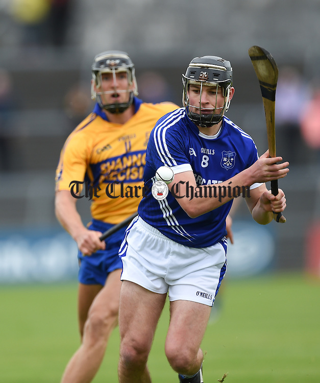 Liam Markham of Cratloe in action against Shane Golden of Sixmilebridge during their game in Cusack Park. Photograph by John Kelly.