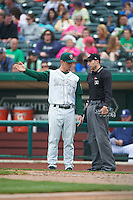 Fort Wayne TinCaps manager Anthony Contreras (10) talks with umpire Sean Markle during the first game of a doubleheader against the Great Lakes Loons on May 11, 2016 at Parkview Field in Fort Wayne, Indiana.  Great Lakes defeated Fort Wayne 3-0.  (Mike Janes/Four Seam Images)