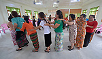 Participants form a circle while giving backrubs during an ecumenical workshop on women's empowerment in Kalay, Myanmar. The workshop was sponsored by the Women's Department of the Myanmar Council of Churches and led by Emma Cantor, a regional missionary for United Methodist Women.