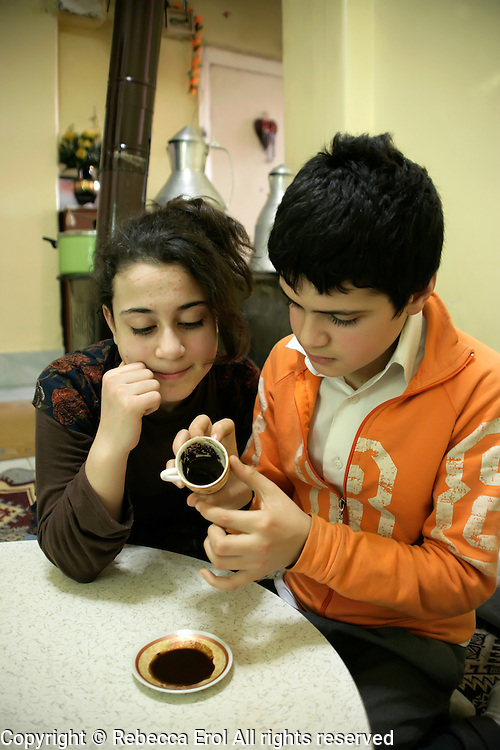 Turkish girl and boy telling their fortune in the coffee grinds, Istanbul, Turkey