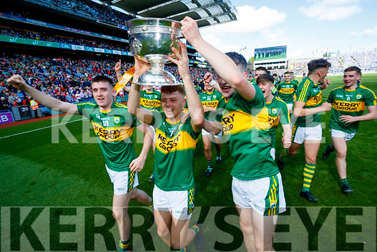 Eddie Horan, Niall Donohue and Chris O'Donoghue Kerry Minors celebrate with the Tom Markham Cup after defeating Derry in the All-Ireland Minor Footballl Final in Croke Park on Sunday.
