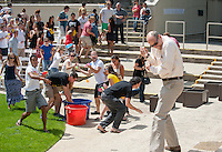 Occidental College President Jonathan Veitch takes on the class of 2011 during an epic water balloon fight at the end of commencement rehearsal on Friday, May 13, 2011 in the Remsen Bird Hillside Theater.<br />