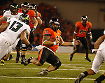 Oregon State Quarterback, 3 Lyle Moevao, slides inside the 5 yard line during the Civil War at Reser Stadium in Corvallis, November 29, 2008.  The Beavers missed the field goal for the score to remain 17-7, Ducks.