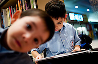 Xavier Garcia (cq, age 4, left) and Joe Garcia IV (cq, age 6) read at the B. Dalton book store, the only book store in Laredo, Texas, US, Wednesday, Dec., 9, 2009. The Laredo, Texas community has voiced its opposition to the closing of the B. With over 95 percent of the population as Hispanic Spanish speakers, Laredo ranked the lowest in literacy rates in the 2000 US census. ..PHOTOS/ MATT NAGER