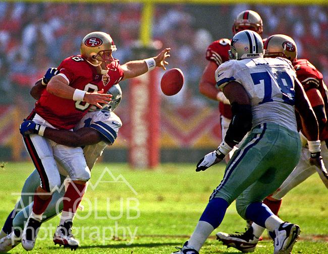 San Francisco 49ers vs. Dallas Cowboys at Candlestick Park Sunday, November 10, 1996.  Cowboys beat 49ers  20-17.  Dallas Cowboys linebacker Broderick Thomas (51) sacks San Francisco 49ers quarterback Steve Young (8) and causes fumble.