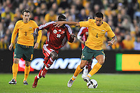 MELBOURNE, AUSTRALIA - OCTOBER 14: Tim Cahill from Australia outruns Fawzi Bashir from Oman in a AFC Asian Cup 2011 match between Australia and Oman at Etihad Stadium on October 14, 2009 in Melbourne, Australia. Photo Sydney Low www.syd-low.com