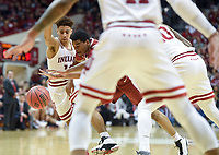 NWA Democrat-Gazette/CHARLIE KAIJO Arkansas Razorbacks guard Mason Jones (13) dribbles surrounded by Indiana Hoosiers defenders during the second half of the NCAA National Invitation Tournament, Saturday, March 23, 2019 at the Simon Skjodt Assembly Hall at the University of Indiana in Bloomington, Ind. The Arkansas Razorbacks fell to the Indiana Hoosiers 63-60.