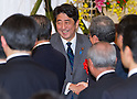 January 7, 2013, Tokyo, Japan - Japan's Prime Minister Shinzo Abe shakes hands with guests during a new year party hosted by the Japanese Trade Union Confederation at a Tokyo hotel on Monday, January 7, 2013. Abe hoped from one party after another, delivering speeches of his economic recovery scenario. (Photo by AFLO)
