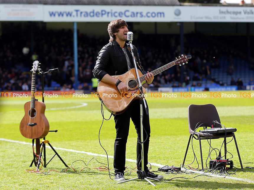 Lifelong Southend fan and singer, Adam Duffill, performs on the pitch pre-match during Southend United vs MK Dons, Sky Bet EFL League 1 Football at Roots Hall on 17th April 2017