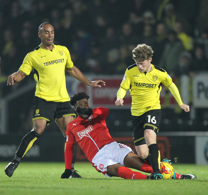 Huddersfield Town's Kasey Palmer tackles Burton Albion's Matt Palmer<br /> <br /> Photographer Mick Walker/CameraSport<br /> <br /> The EFL Sky Bet Championship - Burton Albion v Huddersfield Town - Tuesday 13th December 2016 - Pirelli Stadium - Burton upon Trent<br /> <br /> World Copyright &copy; 2016 CameraSport. All rights reserved. 43 Linden Ave. Countesthorpe. Leicester. England. LE8 5PG - Tel: +44 (0) 116 277 4147 - admin@camerasport.com - www.camerasport.com