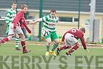 Conor McCarthy Killarney Celtic goes past Adam Quirke and Dara Mullgannon Renmore in Killarney on Saturday