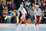 Mannheim, Germany, January 24: During the 1. Bundesliga Damen Hallensaison 2014/15 quarter-final hockey match between Mannheimer HC (white) and Harvestehuder THC (black) on January 24, 2015 at Irma-Roechling-Halle in Mannheim, Germany. Final score 2-3 (2-2). (Photo by Dirk Markgraf / www.265-images.com) *** Local caption *** Friderike Hauschildt #19 of Harvestehuder THC, Sophia Willig #28 of Mannheimer HC, Greta Lyer #10 of Mannheimer HC