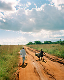 MADAGASCAR, father with son walking down road, Betioky