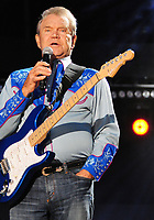 Glen Campbell<br /> 2012 CMA Music Festival Nightly Concert held at LP Field,  Nashville, Tennessee, USA, <br /> 7th June 2012.<br /> half length microphone singing  guitar  blue shirt music country live on stage  concert gig performing <br /> CAP/ADM/LF<br /> &copy;Laura Farr/AdMedia/Capital Pictures